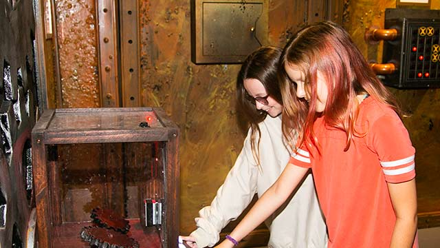 Two players in Antidote escape room at Locktopia Houston