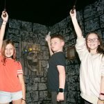 Three kid players at Spellcaster escape room at Locktopia Houston